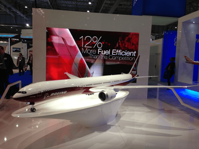Boeing unveiled their 777X program at the 2013 Dubai Air Show. The exhibit model features lighting, moving wingtip parts and a custom lit base. / Photo courtesy of Boeing