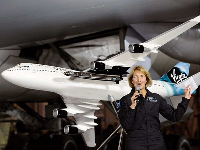 Lieutenant Colonel Kelly Latimer joins Virgin Galactic as their newest pilot. Behind her is a 1/25 scale PacMin Boeing 747-400 exhibit model. // Photo courtesy of Virgin Galactic