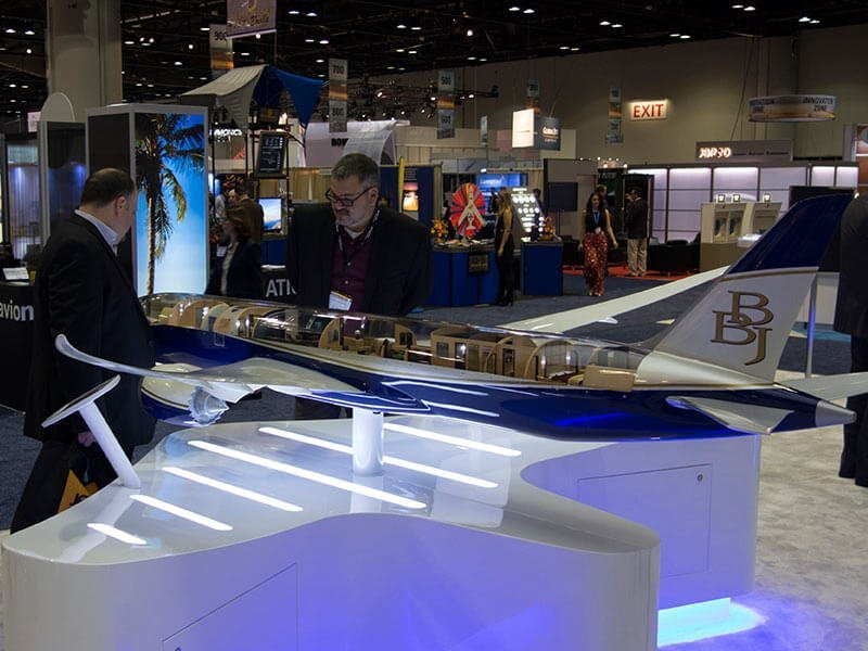 Attendees interact with a 1/20 scale PacMin BBJ cutaway model at NBAA 2014. / Photo courtesy of PacMin