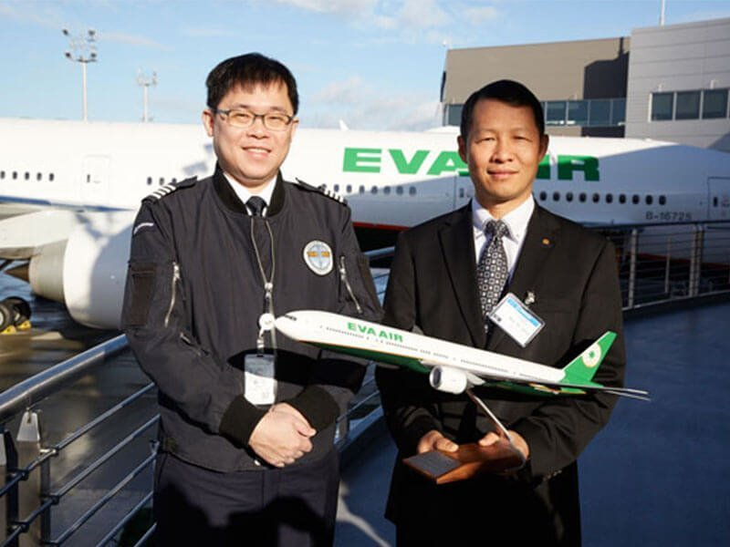 EVA Air chairman K. W. Chang (left) and EVA Air president Austin Cheng with a 1/100 scale PacMin Boeing 777-300ER in EVA Air's new livery. // Photo courtesy of Travel Business