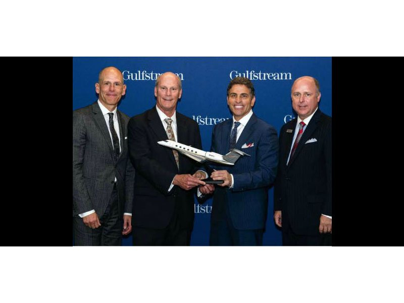 Gulfstream president Larry Flynn (2nd from left) presents Flexjet chairman Kenn Ricci with a model G500, flanked by CEO Mike Silvestro (l) and Scott Neal (r), Gulfstream's senior vice president, worldwide sales and marketing. / Photo courtesy of Aviation Week