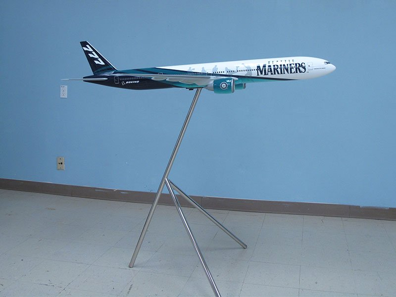 1/50 scale Boeing 777-300ER exhibit model in custom Seattle Mariners livery. Model measures 5 feet (1.5m) long with a 4-foot (1.2m) wingspan.