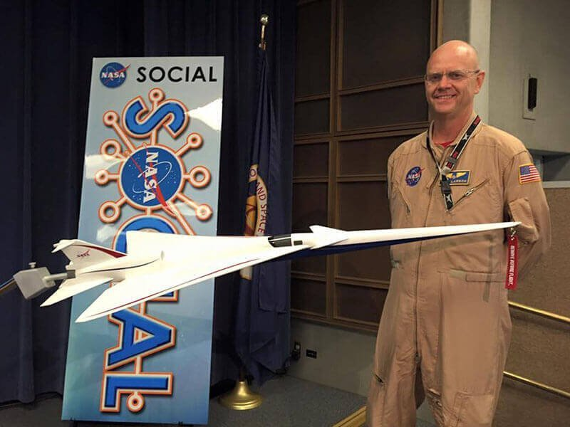 NASA Armstrong Chief Pilot Nils Larson with a 1/20 scale QueSST model which was unveiled at the NASA Social event. The exhibit model measures nearly 5 feet long (1.4 meters) and can be dynamically positioned on the base. / Photo courtesy of NASA Armstrong Flight Research Center
