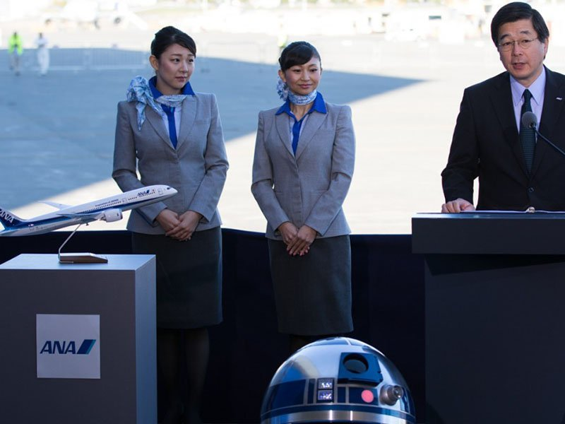 Hideki Kunugi, SVP Americas at ANA, welcomes the R2-D2 Jet as it rolls out of paint at a special event in Everett. // Photo courtesy of All Nippon Airways