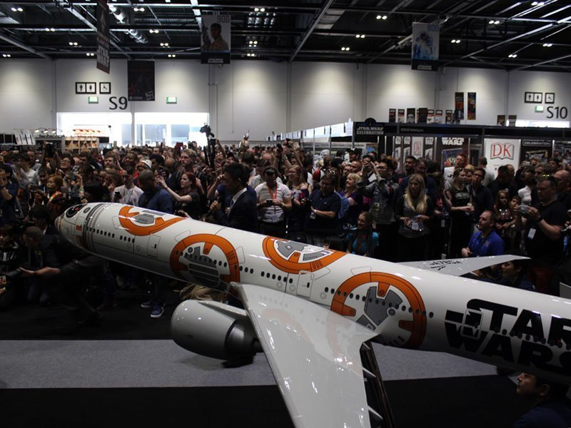 Fans gather around ANA's booth before the unveiling. Pictured is a 1/20 scale 777-300ER BB-8 ANA Jet autographed by the cast of Star Wars: The Force Awakens. The model is 12' long (3.7 m) with a 10.6' wingspan (3.2m). // Photo courtesy of PacMin and ANA