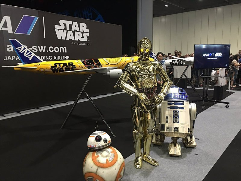 BB-8, C-3PO, and R2-D2 pose in front of the newest Star Wars ANA Jet. // Photo courtesy of Star Wars.