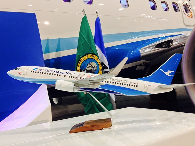 "During the ceremony, Xiamen Airlines was also presented with PacMin 737-800 desktop models in a special ""100th"" livery. // Photo courtesy of ILFC"