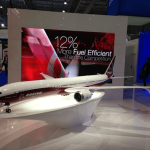 Boeing 777X exhibit model at the 2013 Dubai Air Show, featuring lighting, moving wingtip parts and a custom lit base