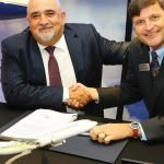Comlux president and CEO Richard Gaona (left) and Boeing Business Jets president Steve Taylor celebrate BBJ Max 8 deal at MEBA. / Photo courtesy of AIN Online