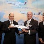 Akbar Al Baker, Qatar chief executive, and Larry Flynn, Gulfstream president, celebrate aircraft order with PacMin desktop model. // Photo courtesy of Qatar