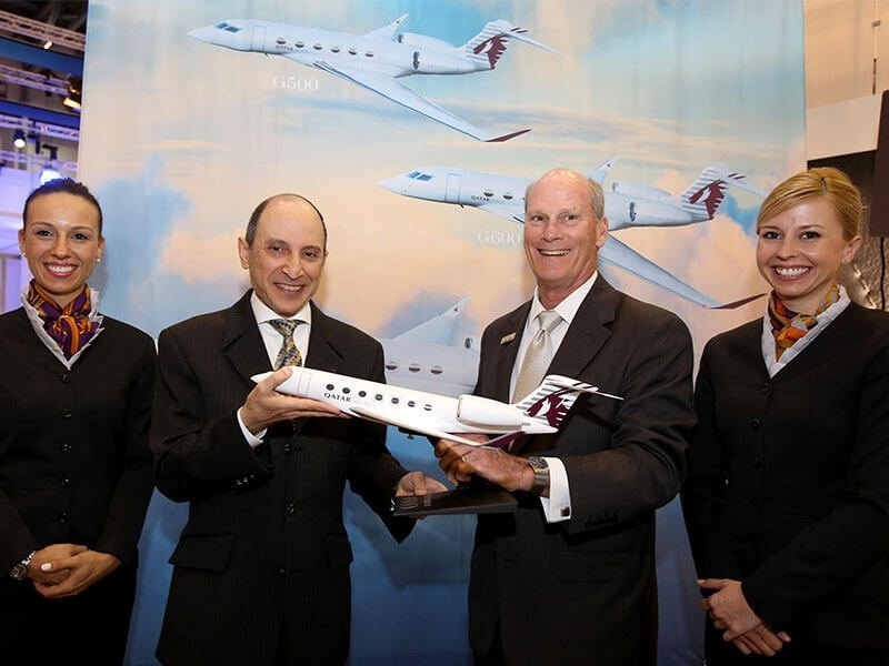 Akbar Al Baker, Qatar chief executive, and Larry Flynn, Gulfstream president, celebrate aircraft order with PacMin desktop model. // Photo courtesy of Qatar