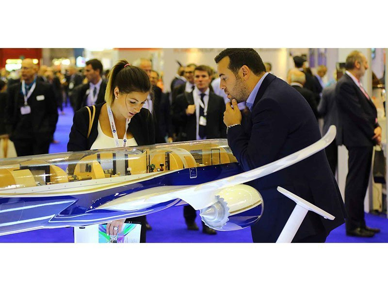 EBACE attendees take a closer look at a PacMin Boeing BBJ cutaway. // Photo courtesy of AIN Online
