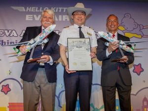 """Andy Icken, Texas Chief Development Officer, K.W. Chang, EVA Air Chairman, and Mario Diaz, Houston Airports Director of Aviation, celebrate the first flight of EVA Air's 777-300ER """"Shining Star"""" Hello Kitty Jet. // Photo courtesy of Getty Images"""