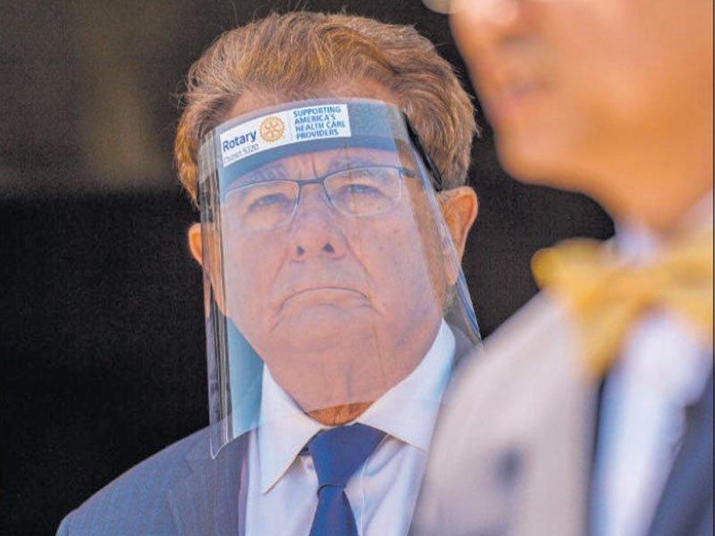 man wearing protective face shield