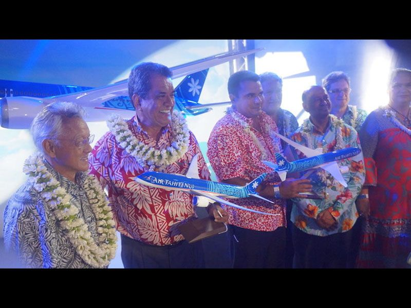 Air Tahiti Nui unveil - seven men wearing leis and two holding models