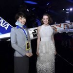 Daisy Ridley who plays Star Wars character Rey with a 1/20 scale BB-8 ANA JET produced by PacMin // Photo courtesy of All Nippon Airways
