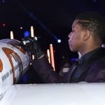 John Boyega who plays Star Wars character Finn autographs a 1/20 scale B-8 ANA JET produced by PacMin // Photo courtesy of All Nippon Airways