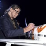 Peter Mayhew who plays Star Wars character Chewbacca autographs a 1/20 scale BB-8 ANA JET produced by PacMin // Photo courtesy of All Nippon Airways