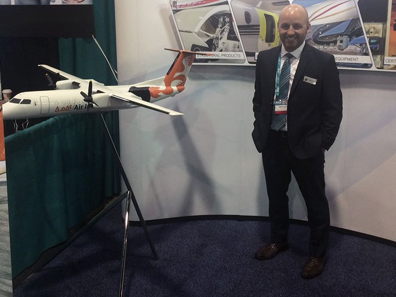 Richard Plourde, B/E Aerospace Director of Sales, with 1/20 scale Bombardier Q300 LCD freighter in Air Inuit livery. The model is 4' long (1.3 m) with a 4.5' wingpsan (1.4 m).