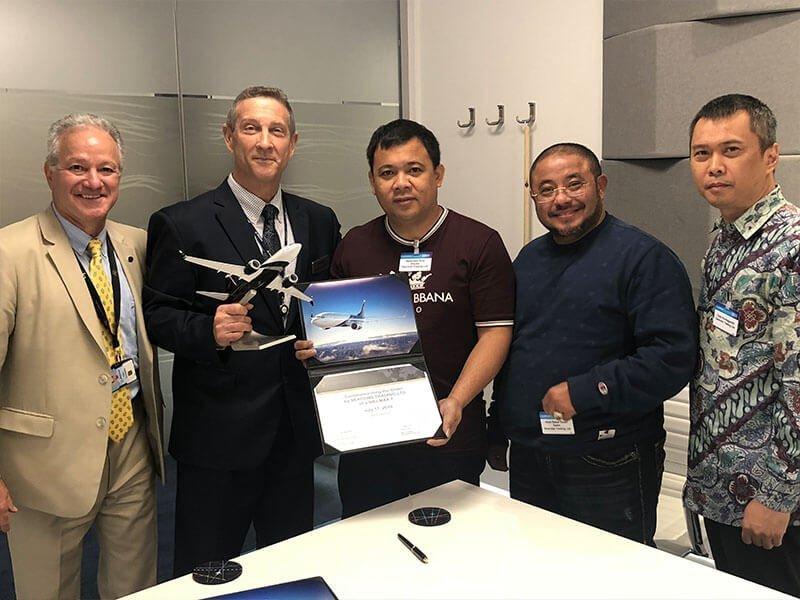 Boeing Seacon - 5 men holding award and plane model