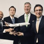 Boeing Vistara - 4 men in suits holding airplane model