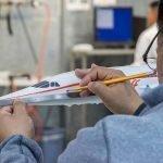 man working on Braniff Concorde model