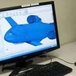 CAD drawing of airplane on computer screen