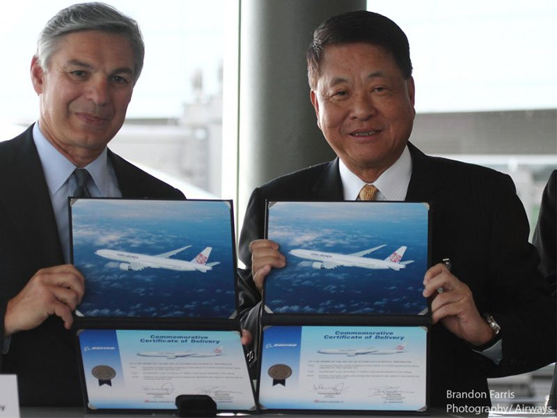 Executives from Boeing and China Airlines celebrate delivery of the airline's first 777-300ER. / Photo courtesy of Airways/Brandon Farris