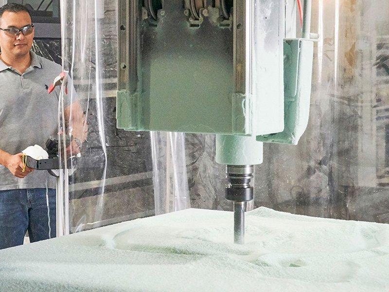 man cutting tool on cnc machine
