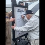 "WWII Vets sign the ""Normandy Board"""