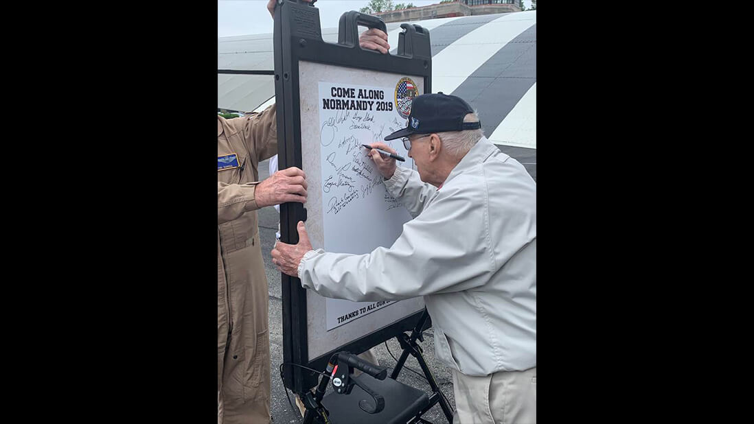 """WWII Vets sign the """"Normandy Board"""""""