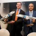 two men holding Egypt Air aviation models