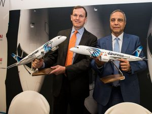 two men holding Egypt Air models