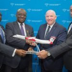 four gentlemen holding custom desktop model at Dubai Air Show