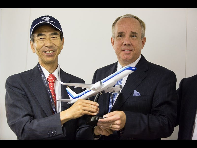 Teruaki Kawai, President and COO of Mitsubishi Aircraft, (left) and Edward Wegel, Eastern Air Lines President and CEO, with MRJ desktop model. / Photo courtesy of Airchive