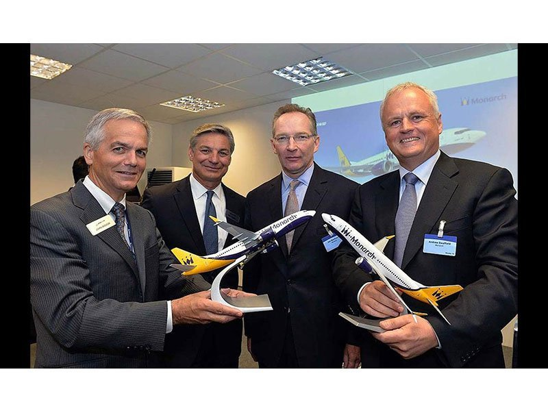 Executives from Boeing and Monarch Airlines celebrate $3.1 billion order at the 2014 Farnborough Air Show. / Photo courtesy of Boeing
