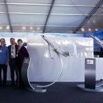 PacMin team with 1/20 scale Gulfstream G500 and G600 models with interactive display stands at NBAA 2014. / Photo courtesy of PacMin