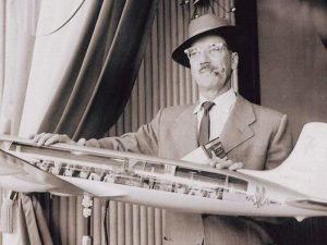 Groucho Marz standing behind AA airplane model