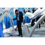 A guest interacts with a fleet of PacMin Gulfstream models at NBAA 2014. / Photo courtesy of NBAA