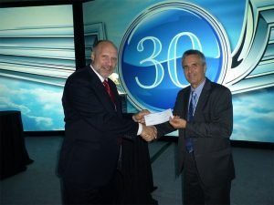 PacMin presents a check to the ISTAT Foundation.