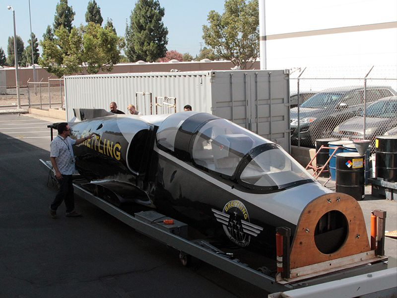 It took a team of a dozen people to unload the Breitling Jet from its trailer and onto braces.