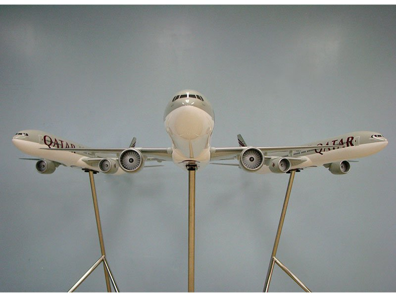 Trio of 1/50 scale Boeing 777-300ER PacMin exhibit models in Qatar Airways livery
