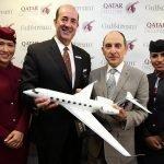 """Qatar Airways CEO Akbar Al Baker and Mark Burns, President, Gulfstream Aerospace at Farnborough 2016. The 1/48 G650 in Qatar livery is 25"""" (63.4 cm) long with a 24.9"""" (63.3 cm) wingspan. / Photo courtesy of Qatar"""