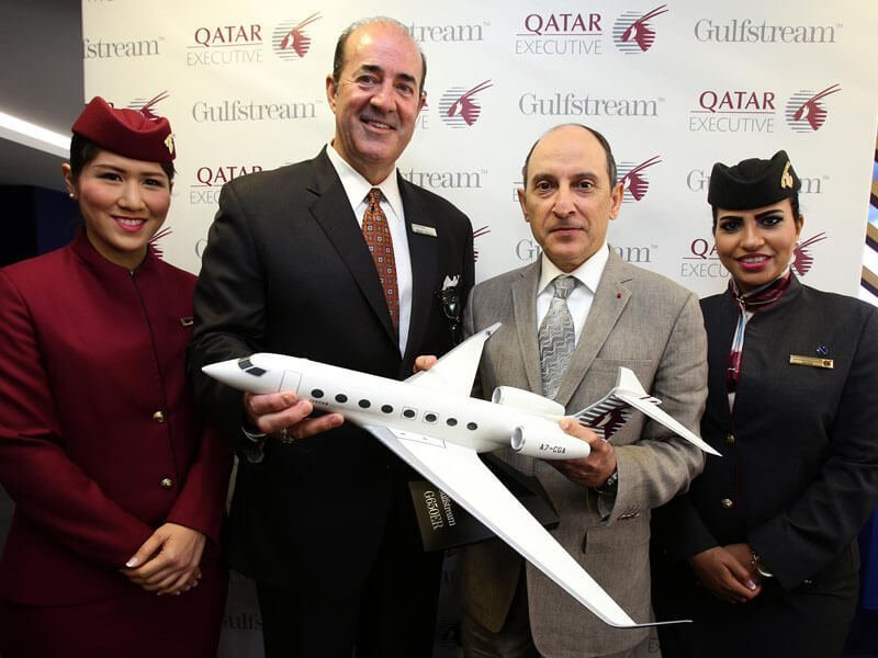 "Qatar Airways CEO Akbar Al Baker and Mark Burns, President, Gulfstream Aerospace at Farnborough 2016. The 1/48 G650 in Qatar livery is 25"" (63.4 cm) long with a 24.9"" (63.3 cm) wingspan. / Photo courtesy of Qatar"