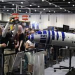 Fans take pictures of a large 1/20 scale R2-D2 ANA Jet that has been autographed by the cast of Star Wars: The Force Awakens. // Photo courtesy of PacMin and ANA
