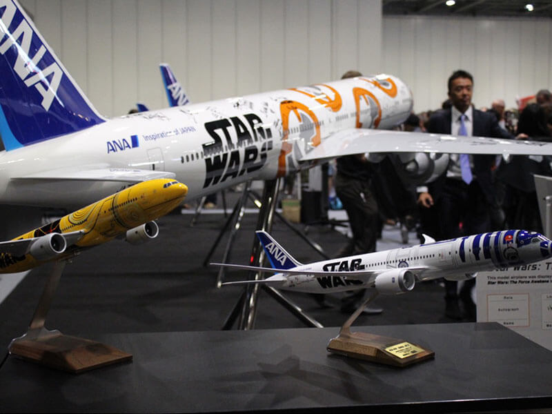 1/100 scale desktop aviation models of each of the ANA Jets on display at ANA's booth at Star Wars Celebration
