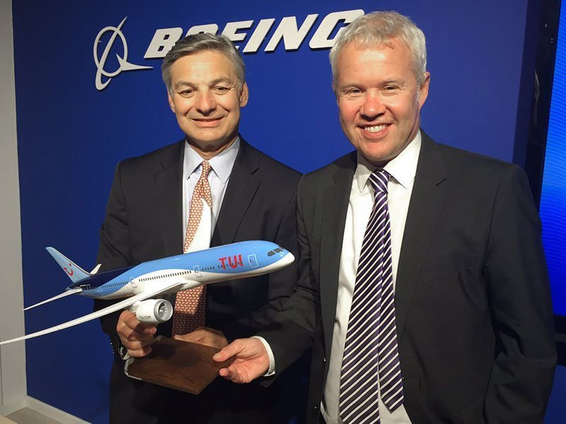 "Ray Conner, president and CEO of Boeing Commercial Airplanes, and David Burling, Member of the Executive Board and responsible for TUI Group Airlines, with a 1/100 scale 787 Dreamliner PacMin model with a 24"" (60 cm) wingspan. / Photo courtesy of Airways"