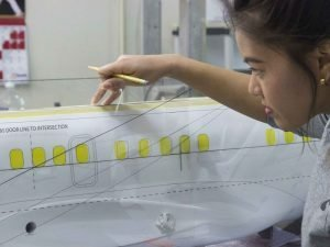 Camille Canlas preparing paint layout for a cutaway model