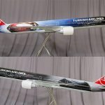 This 1/20 scale 777-300ER Batman v Superman model stretches over 12 feet (3 m) long. It features a Superman image on the right side and a Batman image on the left side.