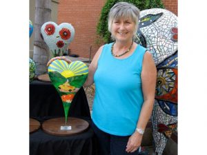 """Artist Marcia Nash with her specially designed 18"""" heart"""
